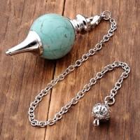 Pendule boule turquoise